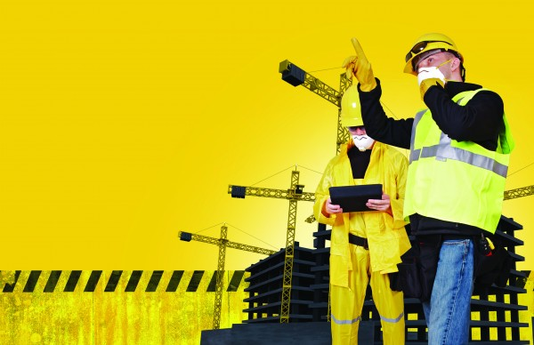 Construction Concept with Construction Site and Two Construction Workers. Yellow Background with Copy Space.