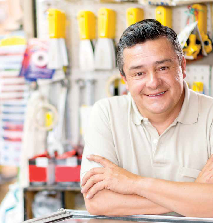Friendly man working at a hardware store looking happy