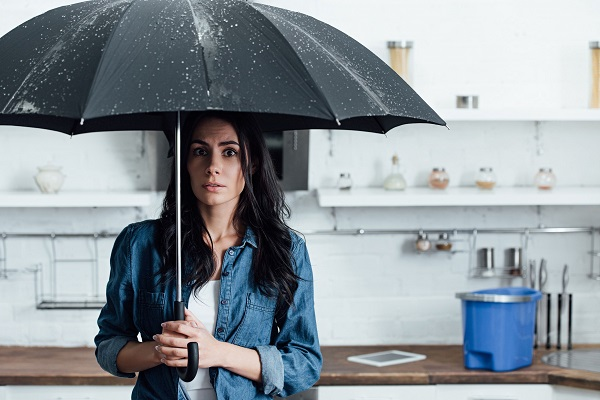 bigstock-amazed-woman-standing-under-um-284214439