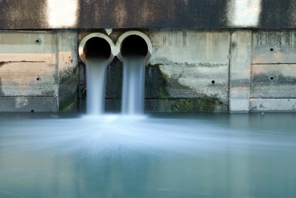 13581809 - dirty drain polluting a river