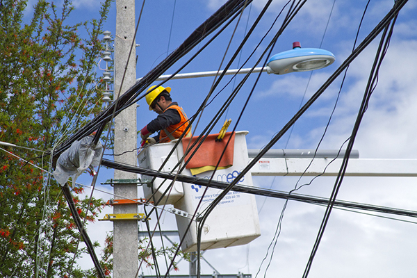Osorno, Chile-November 6, 2011: An electrical power worker works in the connection of an power line in the city grid for the city of Osorno in the state of Los Lagos.