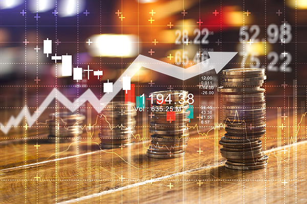 Finance and business concept. Investment graph and rows growth and of coins on table